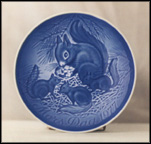 Squirrel And Young Collector Plate by Henry Thelander