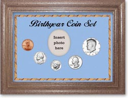 1973 Birth Year Coin Gift Set with a blue background and dark oak frame THUMBNAIL
