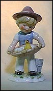 Boy Carrying Eggs, Goebel Lore Blumenkinder Figurine  #11287-13
