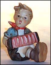 Boy With Accordion, M. I. Hummel Figurine