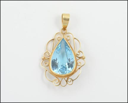 Pear Shaped Topaz Pendant in 14K Yellow Gold