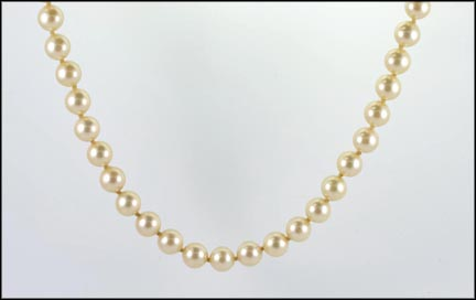 Synthetic Pearl Strand in 14K Yellow Gold