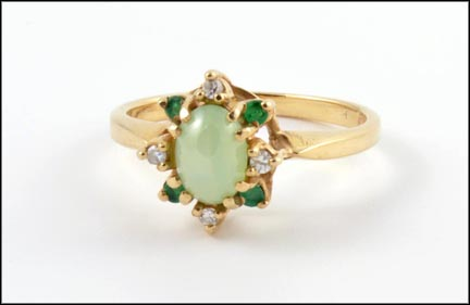 Emerald and Diamond Ring, Center Stone Has Star in 10K Yellow Gold