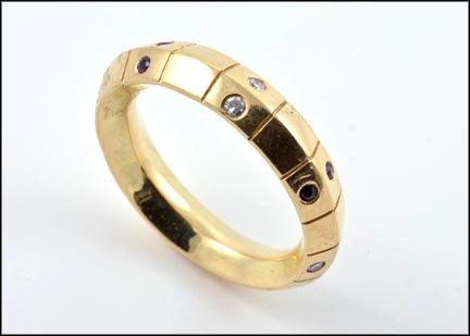 Eight Ruby and Eight Diamond Band in Yellow Gold