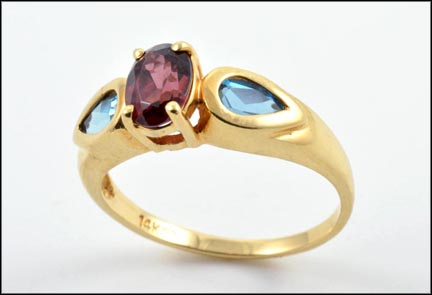 Garnet and Two Blue Topaz Ring in 14K Yellow Gold