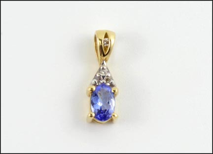 Tanzanite and Four Diamond Pendant in 14K Yellow Gold