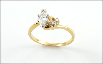 Marquise Cut Diamond with Two Diamond Accent Ring in 14K Yellow Gold
