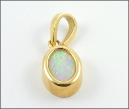Oval Opal Bezel Set Pendant in Yellow Gold