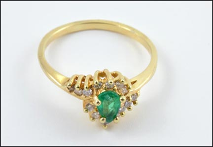 Pear Shaped Emerald and Diamond Accents Ring in Yellow Gold
