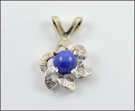 Blue Star Sapphire Pendant in White Gold