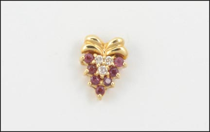 Seven-Ruby and Diamond Pendant in Yellow Gold