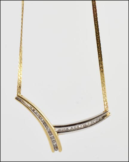 Baguette and Round Channel Set Necklace in 10K Yellow Gold