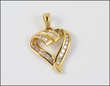 Baguette and Round Brilliant Cut Heart Pendant in 14K Yellow Gold