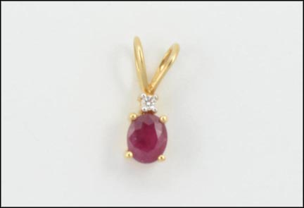 Oval Ruby Pendant in 14K Yellow Gold