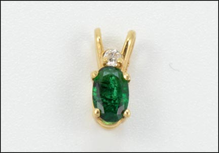 Oval Emerald Pendant in 14K Yellow Gold