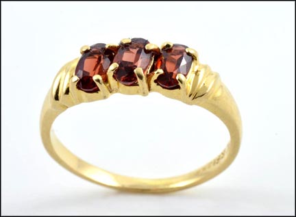 Three Round Garnet Ring in 14K Yellow Gold