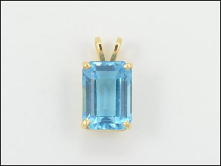 Emerald Cut Blue Topaz Pendant in 14K Yellow Gold