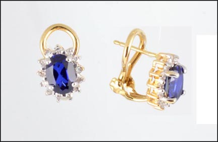 Oval Iolite Omega Earrings in 14K Yellow Gold