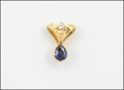 Pear Shaped Sapphire Pendant in 14K Yellow Gold