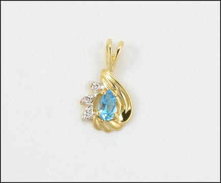 Pear Shaped Blue Topaz Pendant in 14K Yellow Gold