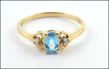 Oval Blue Topaz Ring in 10K Yellow Gold