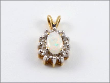 Oval Opal Pendant in 10K Yellow Gold
