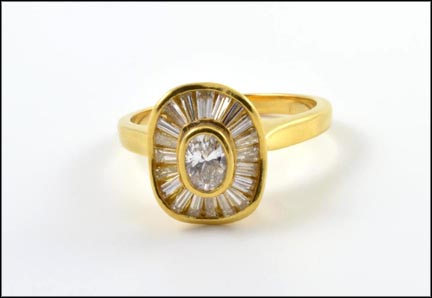 Oval Diamond with Baguettes Ring in 18K Yellow Gold