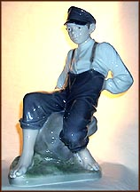 Boy On Stone, Royal Copenhagen Figurine #1659