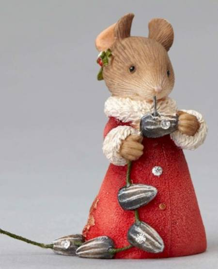 Mouse holding seed garland