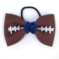 Handmade Football Hair Bow made from real football leather with metallic blue velvet ribbon center