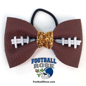 Handmade Football Hair Bow made from real football leather with metallic gold velvet ribbon center