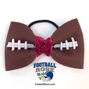 Handmade Football Hair Bow made from real football leather with metallic pink velvet ribbon center