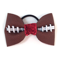 Handmade Football Hair Bow made from real football leather with metallic red velvet ribbon center
