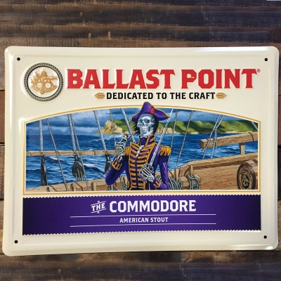 The Commodore Tin Sign