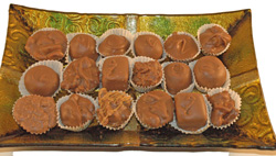 Assorted Chocolates on Glass Candy Tray THUMBNAIL