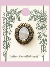 Susan Clarke - Oval Mother of Pearl on Brass Button THUMBNAIL