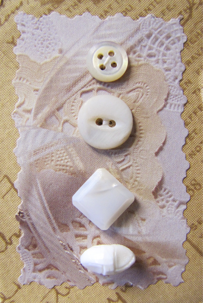 VINTAGE Miscellaneous White and Cream Buttons on Tan Card with White Lace MAIN