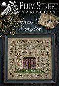 Plum Street Samplers - Crowned Bird Sampler