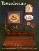 Cover photo of Stoney Creek Book 12 Yesterdreams with cross stitch designs hanging over roll top desk
