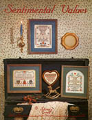 Front cover of Stoney Creek Book 15 Sentimental Values cross stitch designs displayed in a home THUMBNAIL