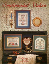 Front cover of Stoney Creek Book 15 Sentimental Values cross stitch designs displayed in a home MAIN