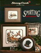 Cover photo of Stoney Creek Book 103 Sporting Adventure showing cross stitch designs for fishermen and hunters