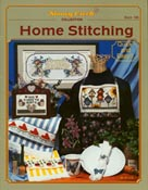 Front cover of Stoney Creek Book 186 Home Stitching showing cross stitch towels apron and more