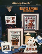 Cover photo of Stoney Creek Book 217 Quilted Kitchen Creations showing cross stitch designs of quilts for the kitchen