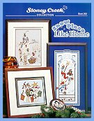 Cover photo of Stoney Creek Book 262 Snow Place Like Home snowmen cross stitch designs