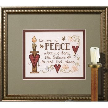 Photo of framed cross stitch At Peace