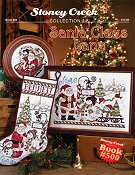 cover of Stoney Creek cross stitch book 500 Santa Claus Lane with annual stocking and 2016 Santa Christmas plate THUMBNAIL