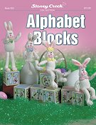 cover photo of Stoney Creek cross stitch Book 502 Alphabet blocks with stuffed bunnies sitting on plastic canvas blocks_THUMBNAIL