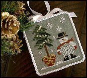 Little House Needleworks - 2010 Ornament #3 - He's A Flake THUMBNAIL