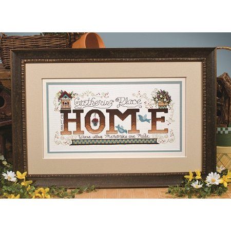 Photo of framed cross stitch Home